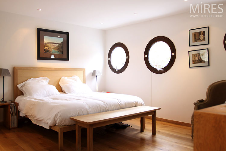 Large bedroom and portholes. C0470