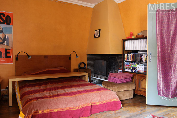 Ocher bedroom and fireplace. C0540