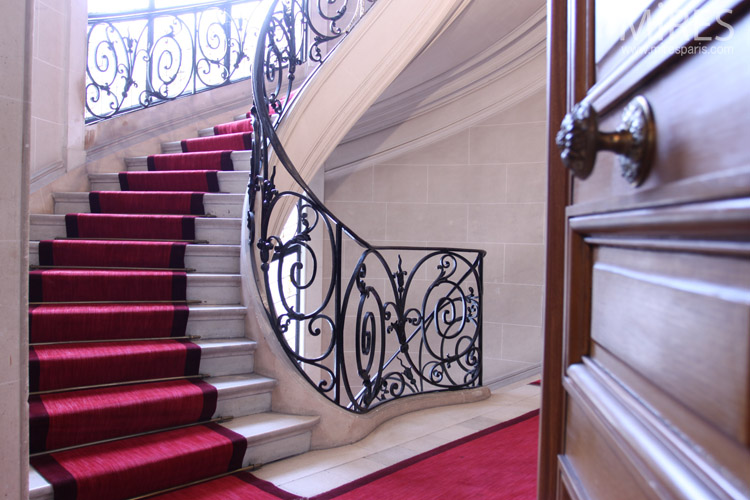 Wrought iron railings and red carpet. C0673
