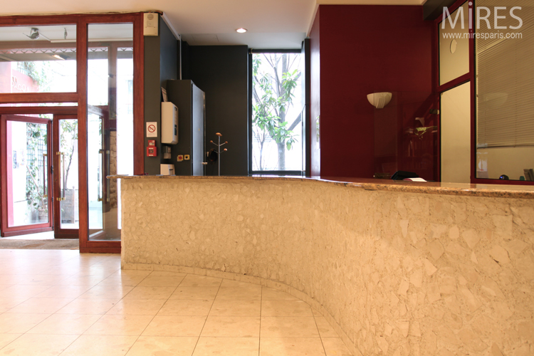 Red and beige reception area with cafetaria. C0685