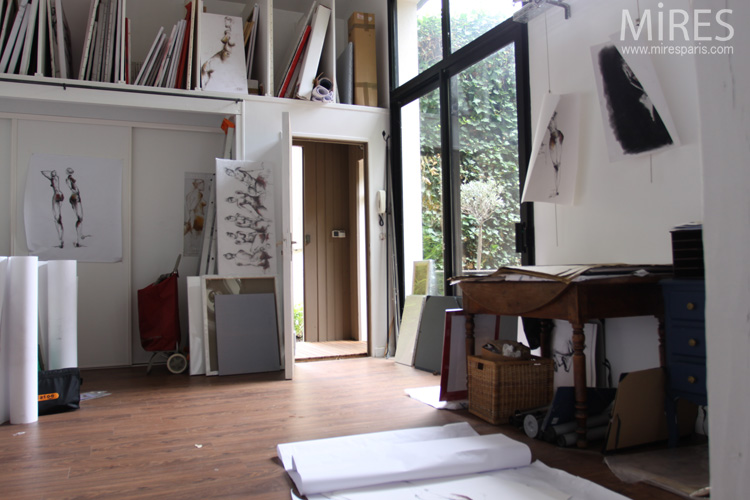 The artist's studio with nudes paintings. C0612