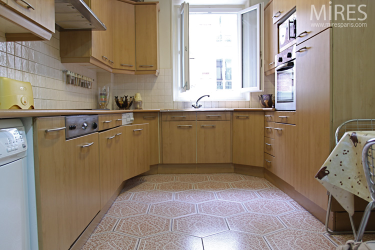 Large  hexagonal tiles and light wood. C0618
