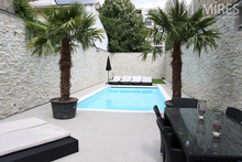 Outdoor swimming pool with palm trees. C0549