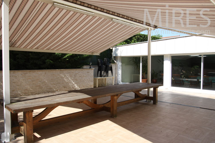 Large table under a tent. C0886