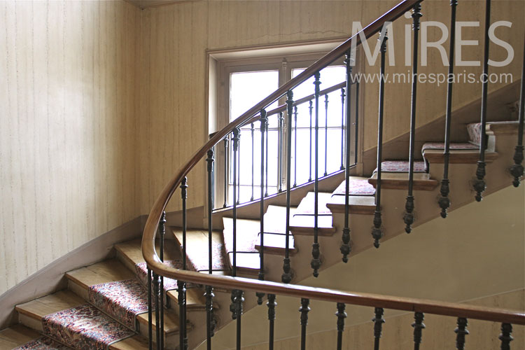 Wooden staircase with threadbare carpet. c0982