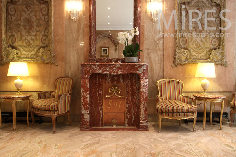 Red marble fireplace. C1008