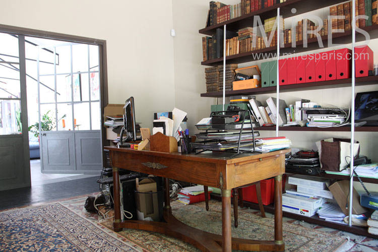 Workshop office with organized disorder. c1032