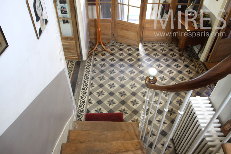 Staircase and tiled entrance. c1044