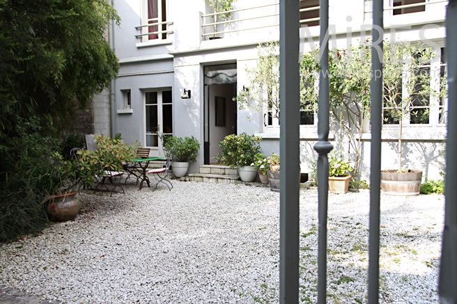 Paved courtyard in front. C1046