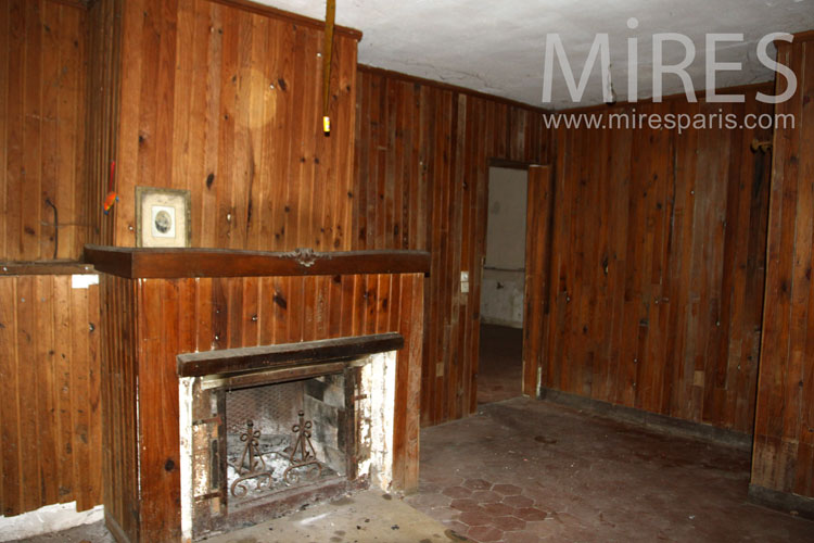 Fireplace and wood paneling. C1078