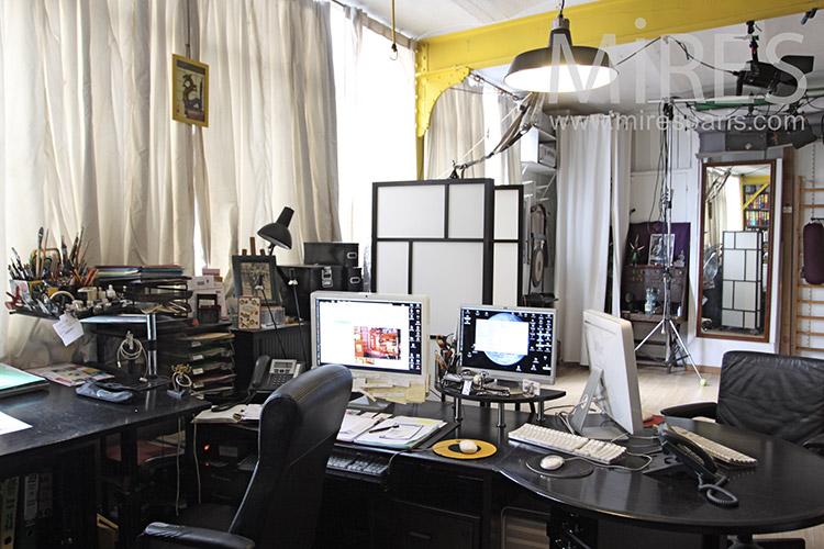Cluttered desk. C1180