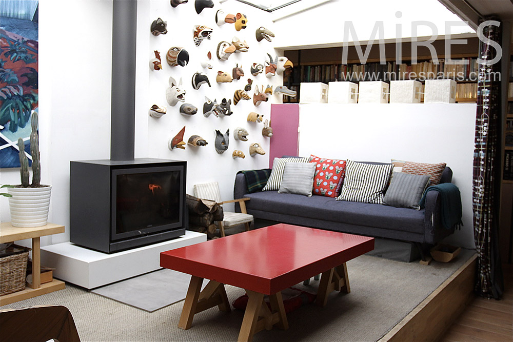 Square lounge and steel fireplace. C1397