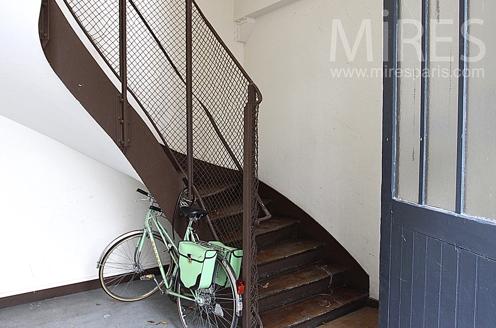 Staircase and bicycle. C1506