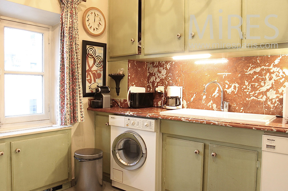 Patinated marble kitchen. c1529
