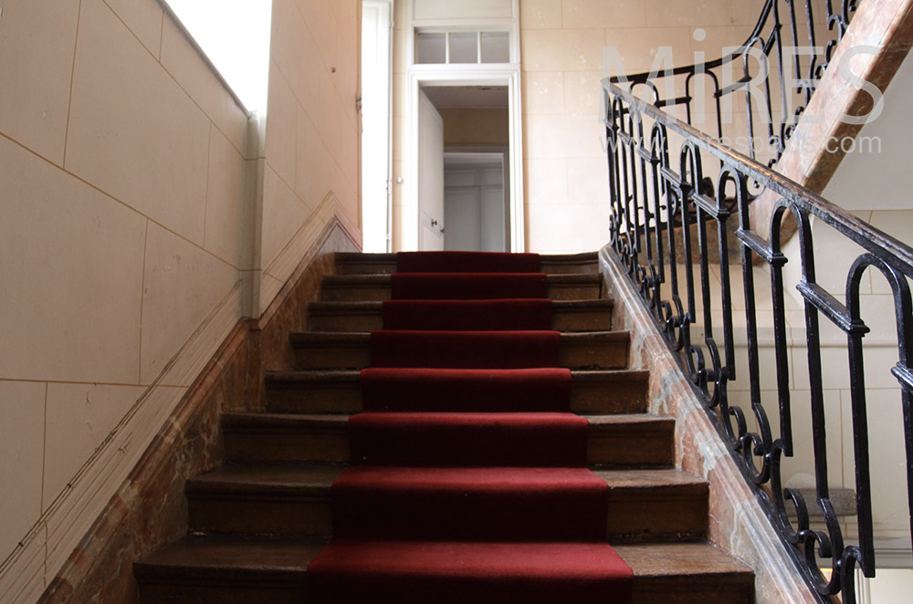 Staircase and red carpet. C1533