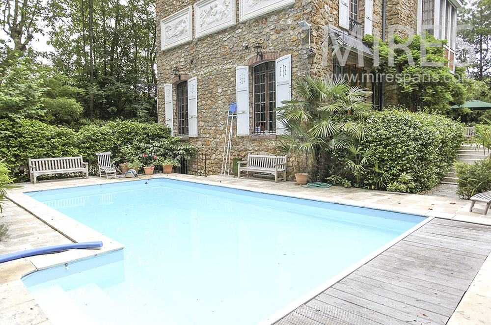 Family millstone, garden and pool. C0156
