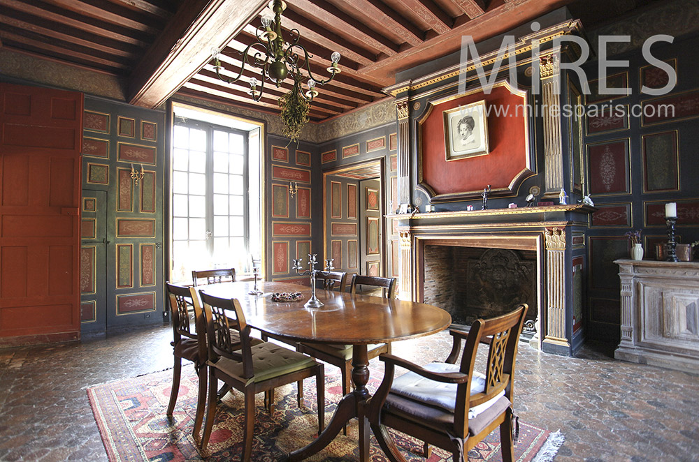Historic dinner with wood paneling. C1590