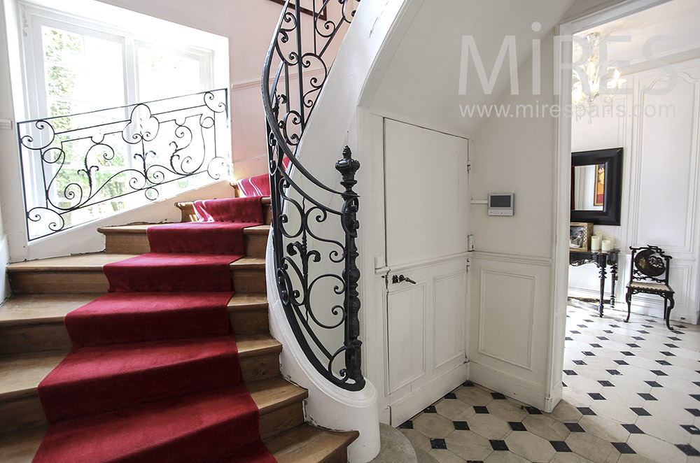 White stairs with red carpet. C1593