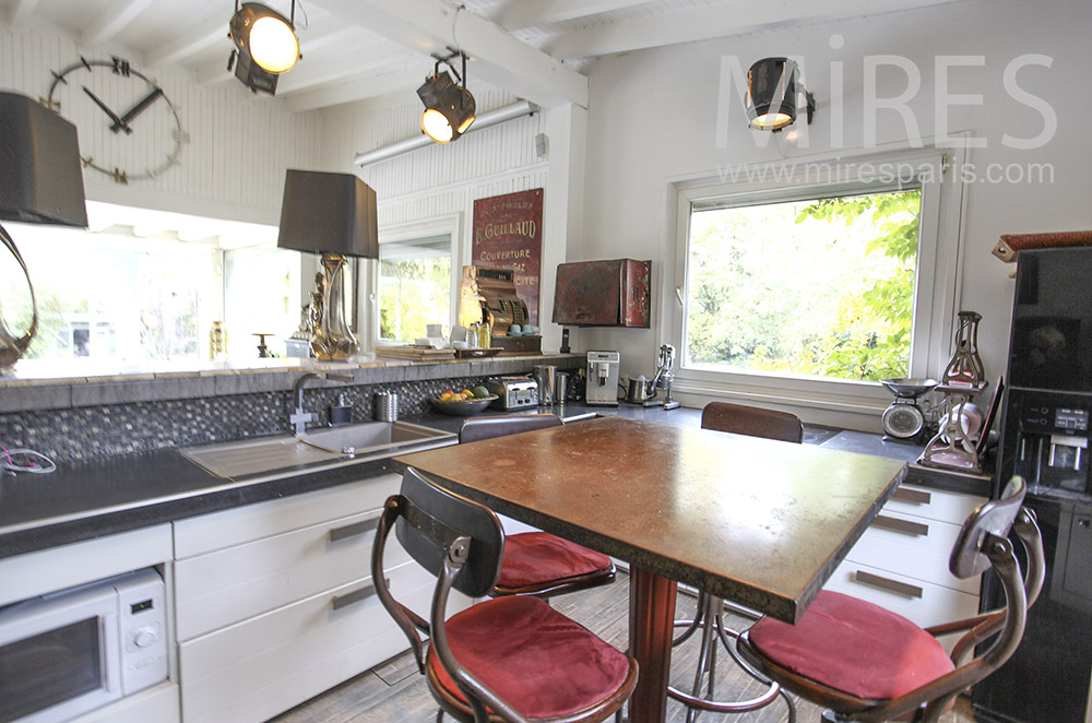 Kitchen With Small High Central Table