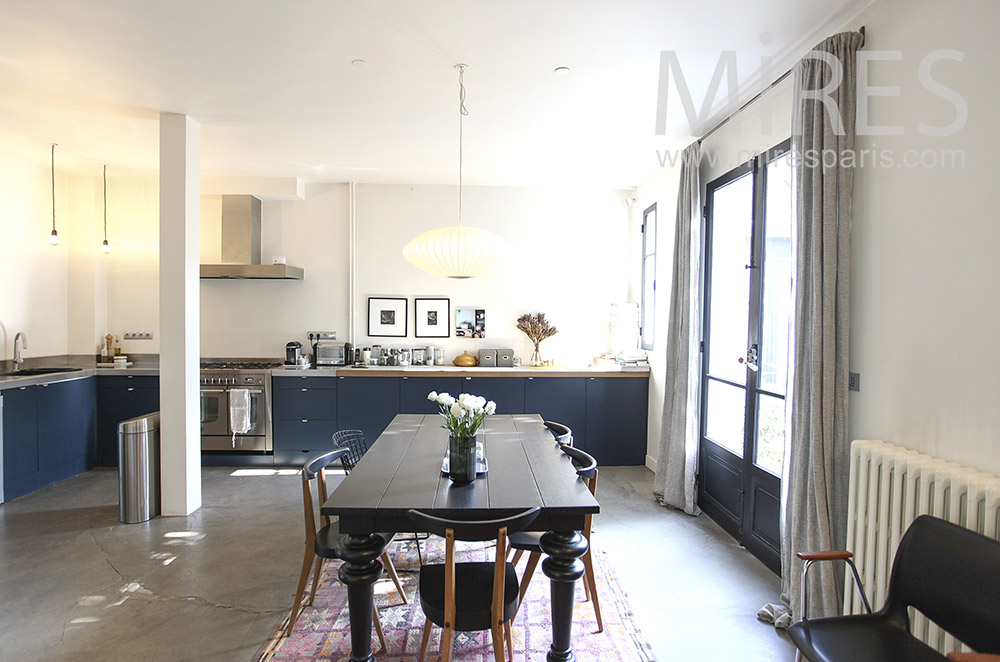 Black table in spacious kitchen. c1614