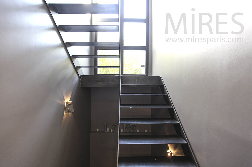 Black metal staircase. C1014