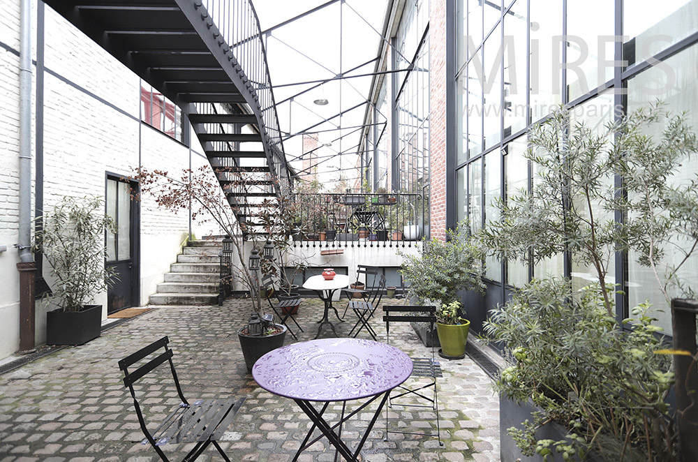 Covered paved terrace. c1647