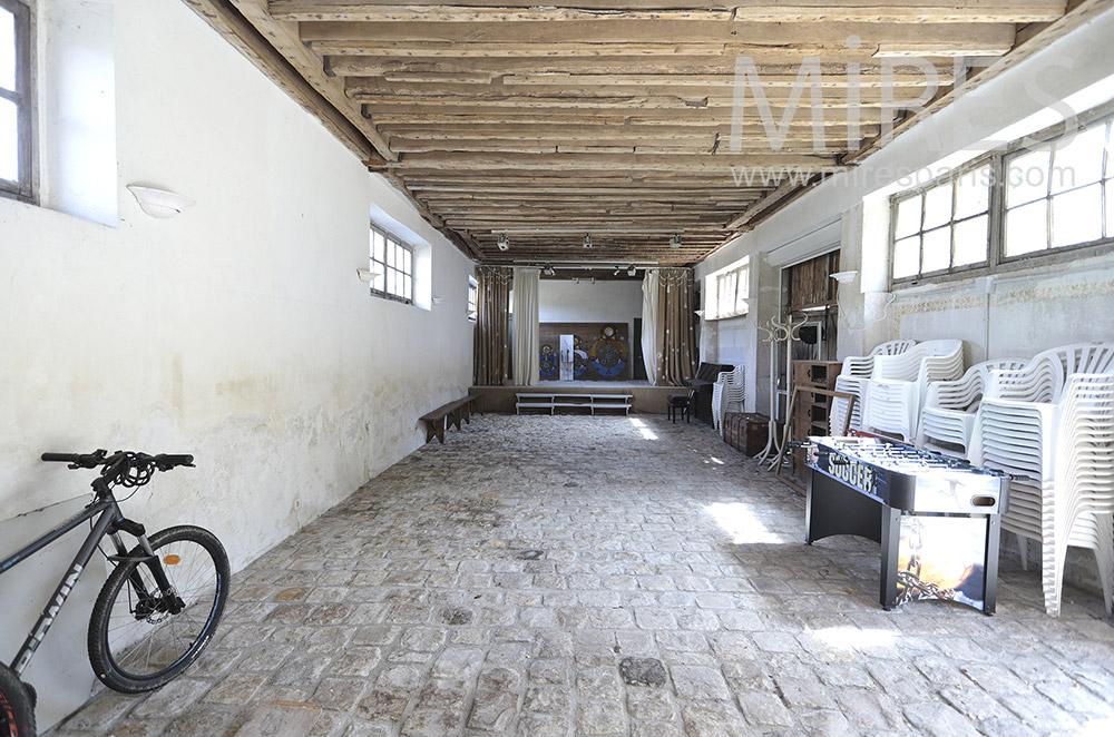 Performance hall, paved floor. C1733