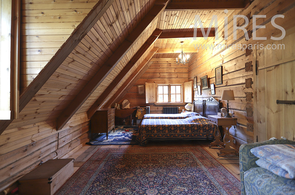 Twin beds under wooden attic. c0224