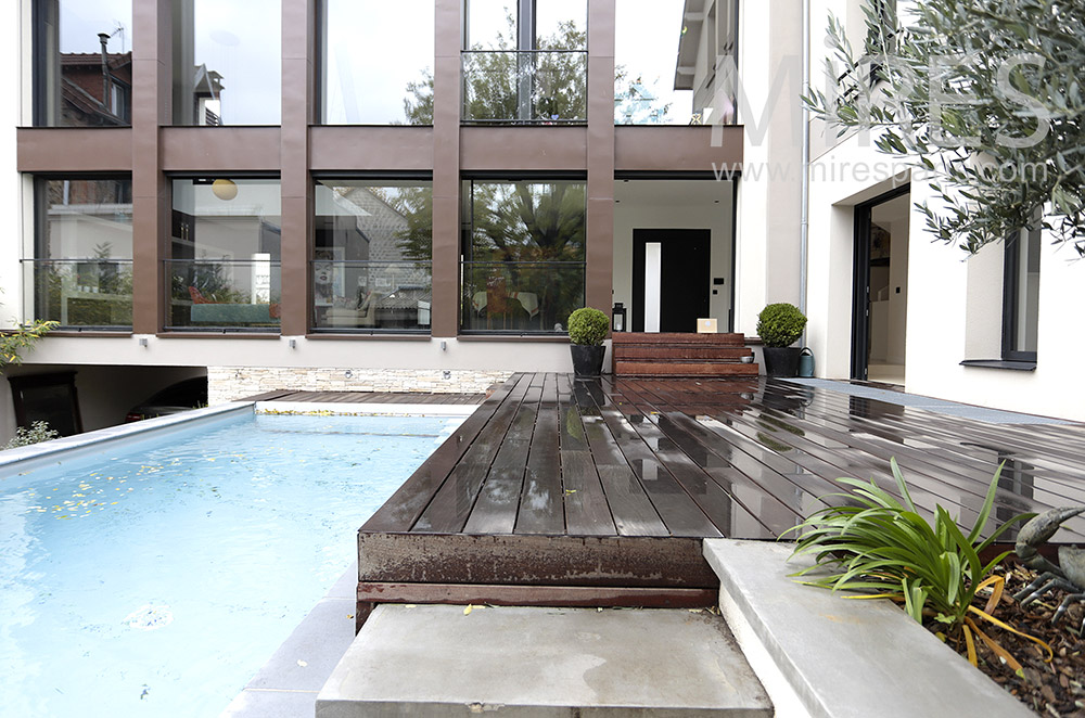 Teak terrace on pool. C1784