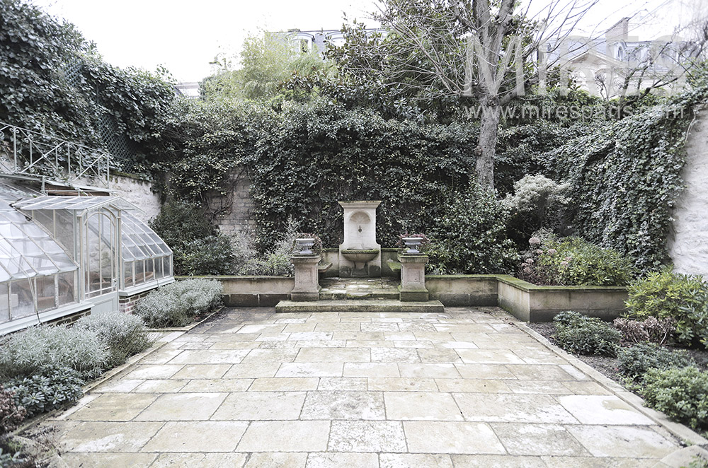 Paved courtyard and fountain. C1808