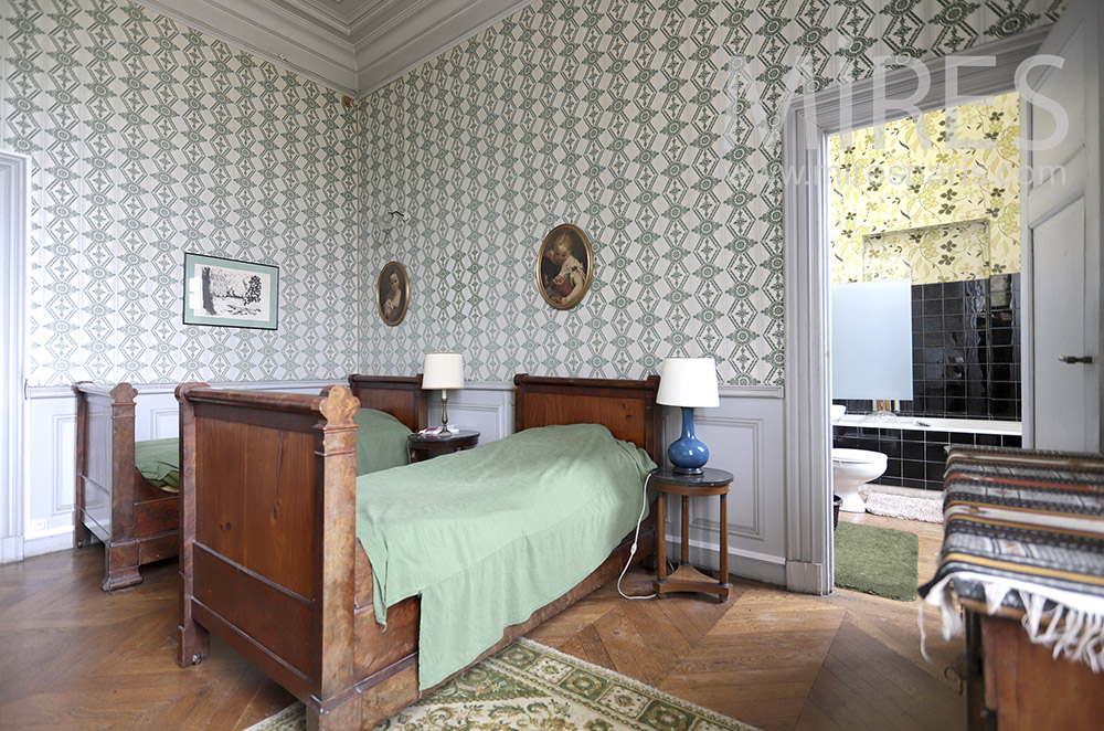 Twin beds and bathroom. C1819