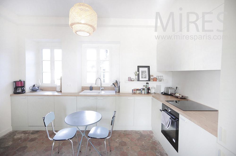White kitchen with terracotta tiles. C1943
